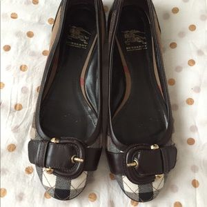 Burberry plaid flats with brown accent bucle.